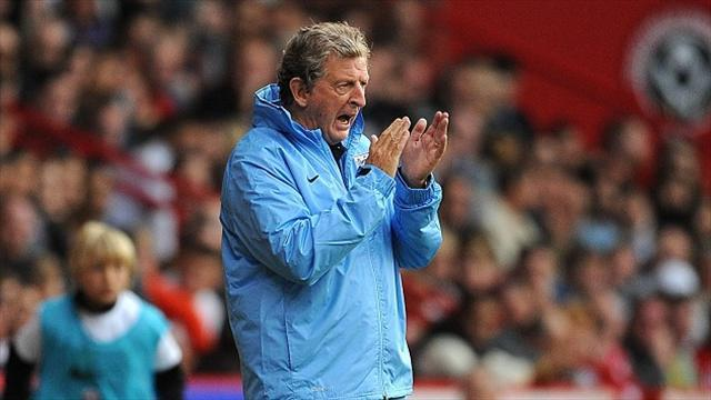 Football - Hodgson backs players after rout