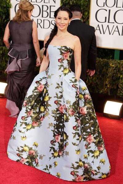 Lucy Liu: Lucy could fit three children inside her voluminous Carolina Herrera gown. This look could easily go the Marie Antoinette way but she keeps it new with a mermaid side braid and subtle jewelry. (Photo by Jeff Vespa/WireImage)