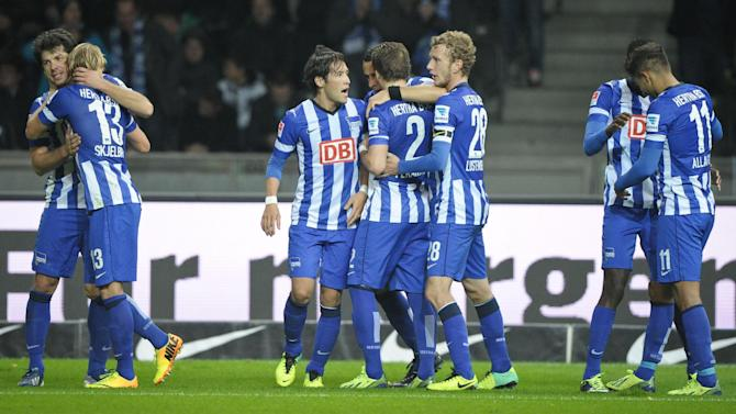 Berlin's players celebrate their side's opening goal during the German first division Bundesliga soccer match between Hertha BSC Berlin and Borussia Moenchengladbach, in Berlin, Germany, Saturday, Oct. 19, 2013