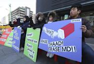 """South Korean protesters stage a rally to oppose a plan to deploy an advanced U.S. missile defense system called Terminal High-Altitude Area Defense, or THAAD, and upcoming joint military exercises, dubbed Key Resolve and Foal Eagle, between the U.S. and South Korea, near the U.S. Embassy in Seoul, South Korea, Tuesday, Feb, 14, 2017. The U.N. Security Council strongly condemned North Korea late Monday over its latest ballistic missile launches and warned of """"further significant measures"""" if Pyongyang doesn't stop nuclear and missile testing. (AP Photo/Ahn Young-joon)"""