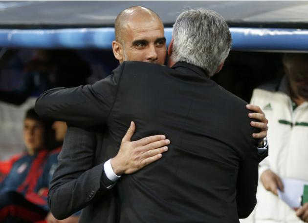 Bayern Munich's coach Guardiola embraces Real Madrid's coach Ancelotti before the kick off of their Champions League semi-final first leg soccer match at Santiago-Bernabeu stadium in Madrid