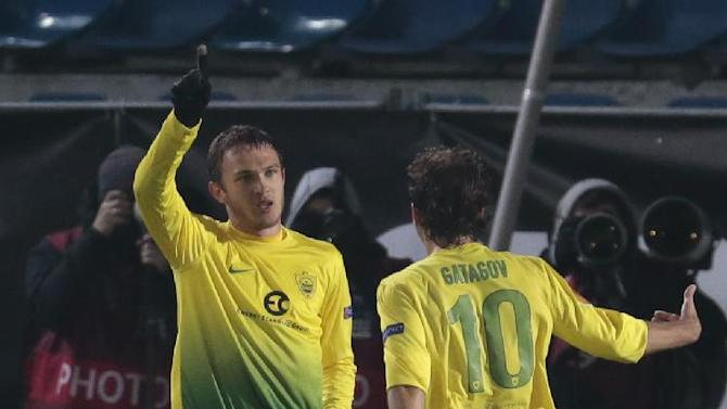 Anzhi's Nikita Burmistrov, left, celebrates his goal against Tromso with teammate Alan Gatagov during the Europa League group K soccer match between Anzhi Makhachkala and Tromso IL at Saturn stadium in Ramenskoye, outside Moscow, in Russia, on Thursday, Oct. 24, 2013