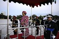Joyce Banda inspects the guard of honour during her inauguration as new president. She faces the challenge of leading a country whose parliament is dominated by Mutharika's party, at the head of a cabinet that includes ministers vocally opposed to her