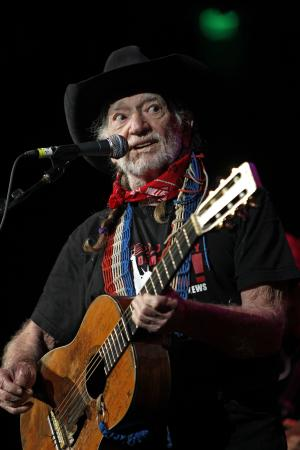 """FILE - This Oct. 17, 2011 file photo shows country singer Willie Nelson during """"Fire Relief, The Concert For Central Texas"""" at the Frank Erwin Center in Austin, Texas. Nelson will be joined by Toby Keith, Zac Brown Band and Darius Rucker on Nelson's song """"Roll Me Up"""" on Wednesday's, June 6, 2012, CMT Awards. (AP Photo/Erich Schlegel, file)"""