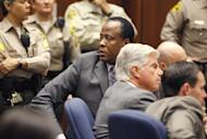 Dr. Conrad Murray turns to the courtroom audience after he was sentenced to four years in county jail for his involuntary manslaughter conviction in the death of pop star Michael Jackson on Tuesday, Nov. 29, 2011 in Superior Court in Los Angeles. (AP Photo/Mario Anzuoni, Pool)