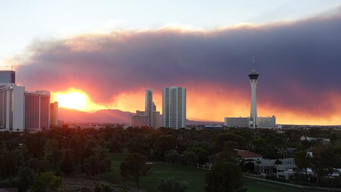 Smoke pouring from the fires in the Mount Charleston area west of Las Vegas created a fiery sunset on Monday July 8, 2013. (AP Photo/Las Vegas Review-Journal, Norm Clarke)