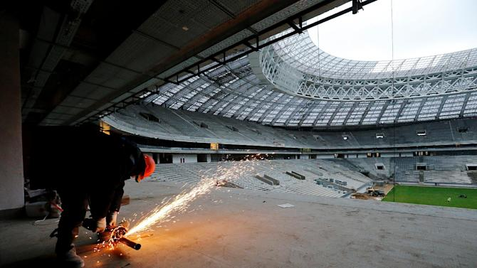 Labourer works at Luzhniki Stadium under reconstruction that will host 2017 FIFA Confederations Cup and 2018 FIFA World Cup matches in Moscow
