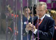 IOC President Jacques Rogge signs the Olympic Wall of Truce to mark the 40th anniversary of deadly attacks on Israeli athletes at the 1972 Munich Games during a visit to the Olympic Village in London four days before the start of the London 2012 Olympic Games