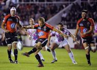 Toulon's fly-half Jonny Wilkinson kicks and scores during a European Challenge Cup rugby union match in the French southern city of Toulon. Wilkinson kicked a last-minute, long-distance drop goal to give Toulon a thrilling 32-29 victory over Stade Francais on Friday and a place in the European Challenge Cup final