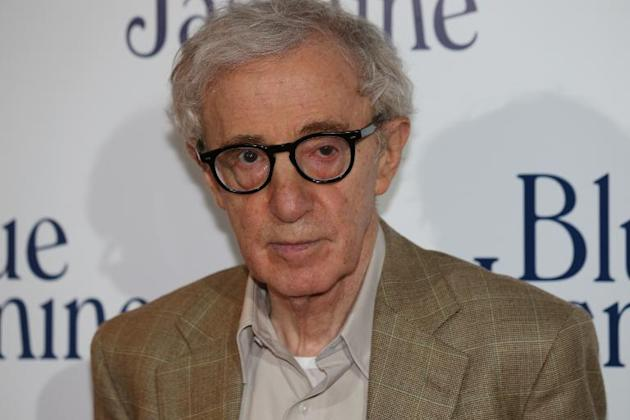 "US film director Woody Allen poses during the French premiere screening of ""Blue Jasmine"" in Paris on August 27, 2013"