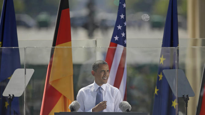 "President Barack Obama speaks in front of the iconic Brandenburg Gate in Berlin Germany, Wednesday, June 19, 2013. Obama is planning a major push using executive powers to tackle the pollution blamed for global warming in an effort to make good on promises he made at the start of his second term. ""We know we have to do more — and we will do more,"" Obama said in Berlin. (AP Photo/Pablo Martinez Monsivais)"