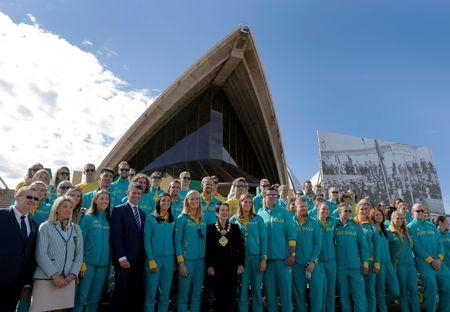 Sydney's Lord Mayor Clover Moore poses for a picture with Australia's Olympic athletes returning from Rio during an official welcome ceremony at the Sydney Opera House in Australia