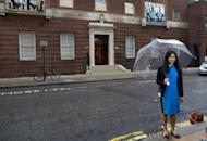 A reporter prepares to go on camera outside the Lindo Wing at St Mary's Hospital in London on June 20, 2013. Prince William's wife Catherine is not officially due to give birth for two weeks but the world's media began gathering outside the London hospital where she will have the baby, determined not to miss the photograph of the year