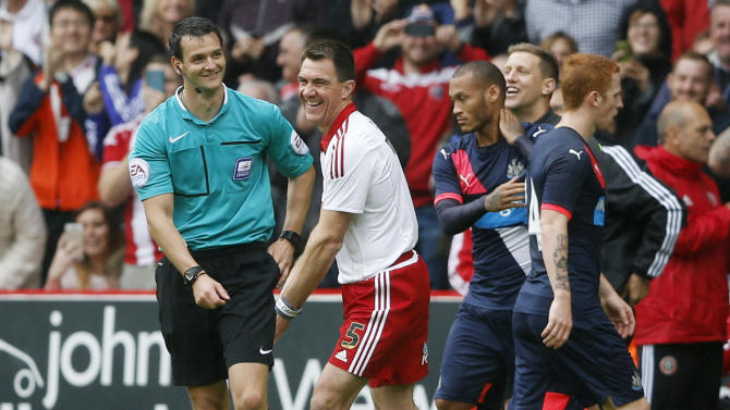 Chris Morgan and the referee share a joke after he pretended to send Morgan off seconds after coming on as a substitute