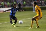 Queretaro's Ronaldinho (L) kicks the ball past Tigres' Jose Rivas during their Copa MX soccer match at the Corregidora stadium in Queretaro September 17, 2014. The 34-year-old forward, who signed for the provincial club known as Gallos Blancos (White Roosters) just before the transfer window closed, played in his first official match in Mexico Wednesday. REUTERS/Juvencio Hernandez (MEXICO - Tags: SPORT SOCCER)
