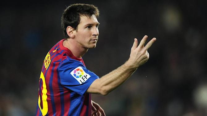 FC Barcelona's Lionel Messi, from Argentina, reacts after scoring against Mallorca during a Spanish La Liga soccer match at the Camp Nou stadium in Barcelona, Spain, Saturday, Oct. 29, 2011. (AP Photo / Manu Fernandez)