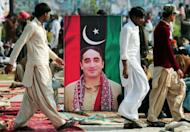 A portrait of Bilawal Bhutto Zardari outside the Bhutto family mausoleum in Garhi Dera Bakhsh on Thursday. The son of Pakistan's slain former prime minister Benazir Bhutto launched his political career Thursday on the anniversary of his mother's death, vowing to continue her fight for democracy.