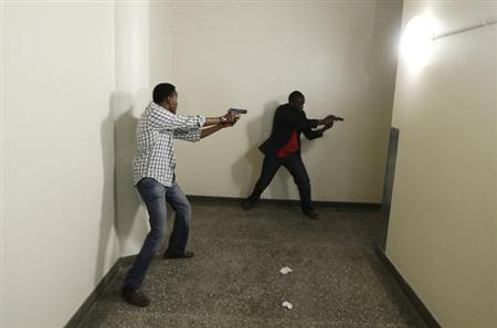 Armed police search Westgate Shopping Centre in Nairobi, September 21, 2013. REUTERS/Goran Tomasevic