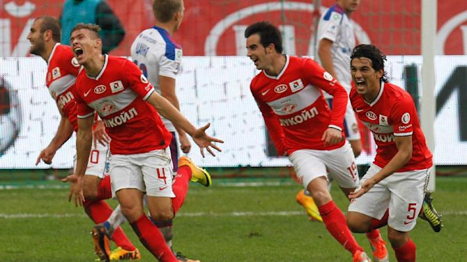Spartak's Sergei Parshivlyuk, second left, celebrates a goal with his teammates during a Russian Premier League Championship soccer match between CSKA Moscow and Spartak Moscow at the Lokomotiv stadium in Moscow, Russia, Sunday, Sept. 22, 2013. Spartak won 3-0