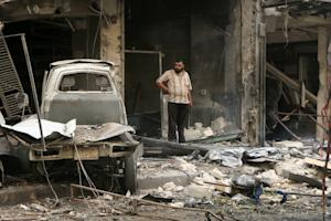 A Syrian man inspects the damage after a reported missile…