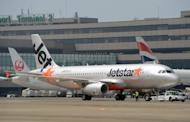 Asian low cost carrier JetStar's airbus jetliner taxies at the Narita International airport on July 19, 2012, Tokyo. Jetstar apologised on Friday after refusing to allow the grieving mother of a New Zealand man killed in a shark attack to change her flight on compassionate grounds