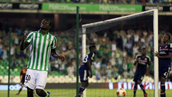 Real Betis' Igiebor reacts after missing a scoring opportunity against Olympique Lyon during their Europa League soccer match in Seville