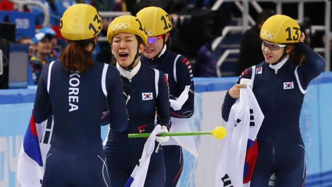 South Korea's skating team celebrates after winning the women's 3,000 metres short track speed skating relay final event in the Iceberg Skating Palace at the Sochi 2014 Winter Olympics