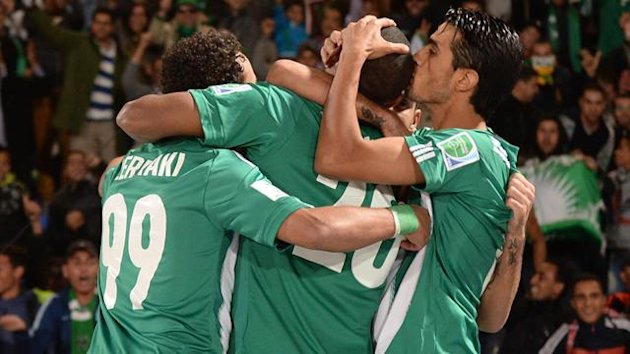 Morocco Raja Casablanca's players celebrate after scoring a goal against Brazil's Atletico Mineiro (AFP)