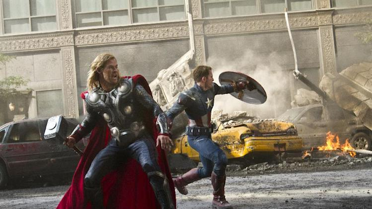 "In this film image released by Disney, Chris Hemsworth portrays Thor, left, and  and Chris Evans portrays Captain America in a scene from ""The Avengers,"" expected to be released on May 4, 2012. (AP Photo/Disney, Zade Rosenthal)"