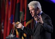 "Former US president Bill Clinton is pictured during a speech in Washington, DC on April 29, 2013. ""Jason (Collin's) announcement today is an important moment for professional sports and in the history of the LGBT (Lesbian-Gay-Bisexual-Transgender) community,"" Clinton said"