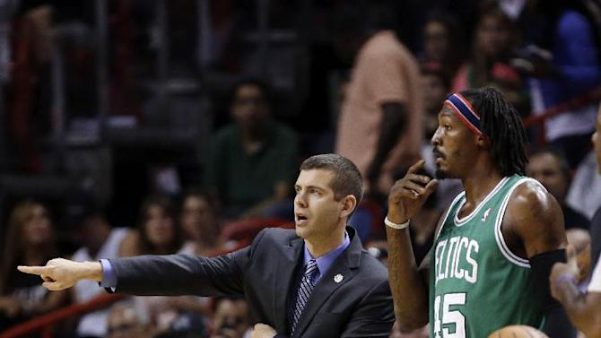 Boston Celtics' head coach Brad Stevens, left, gestures as he stands with Gerald Wallace during the first half of an NBA basketball game against the Miami Heat, Saturday, Nov. 9, 2013, in Miami. The Celtics won 111-110