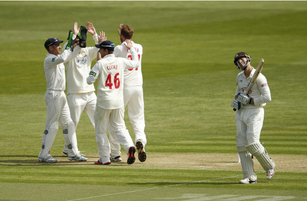 Cricket: Glamorgan's Andrew Carter celebrates with team mates after taking the wicket of Surrey's Zafar Ansari