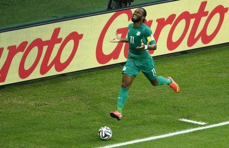Ivory Coast's Didier Drogba runs after the ball during the 2014 World Cup Group C soccer match against Greece at the Castelao arena in Fortaleza June 24, 2014