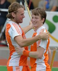 Bob de Voogd of The Netherlands (L) congratulates a smiling Seve van Ass after he scored against Pakistan in their Champions Trophy win. The Netherlands will now face the winner of Saturday's other semi-final between Australia and India in Sunday's final