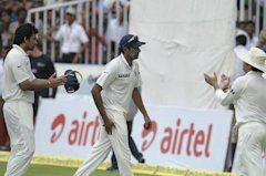 Ashwin is applauded by teammates as he walks back after the completion of New Zealand's first innings during the third day of the first Test between I...