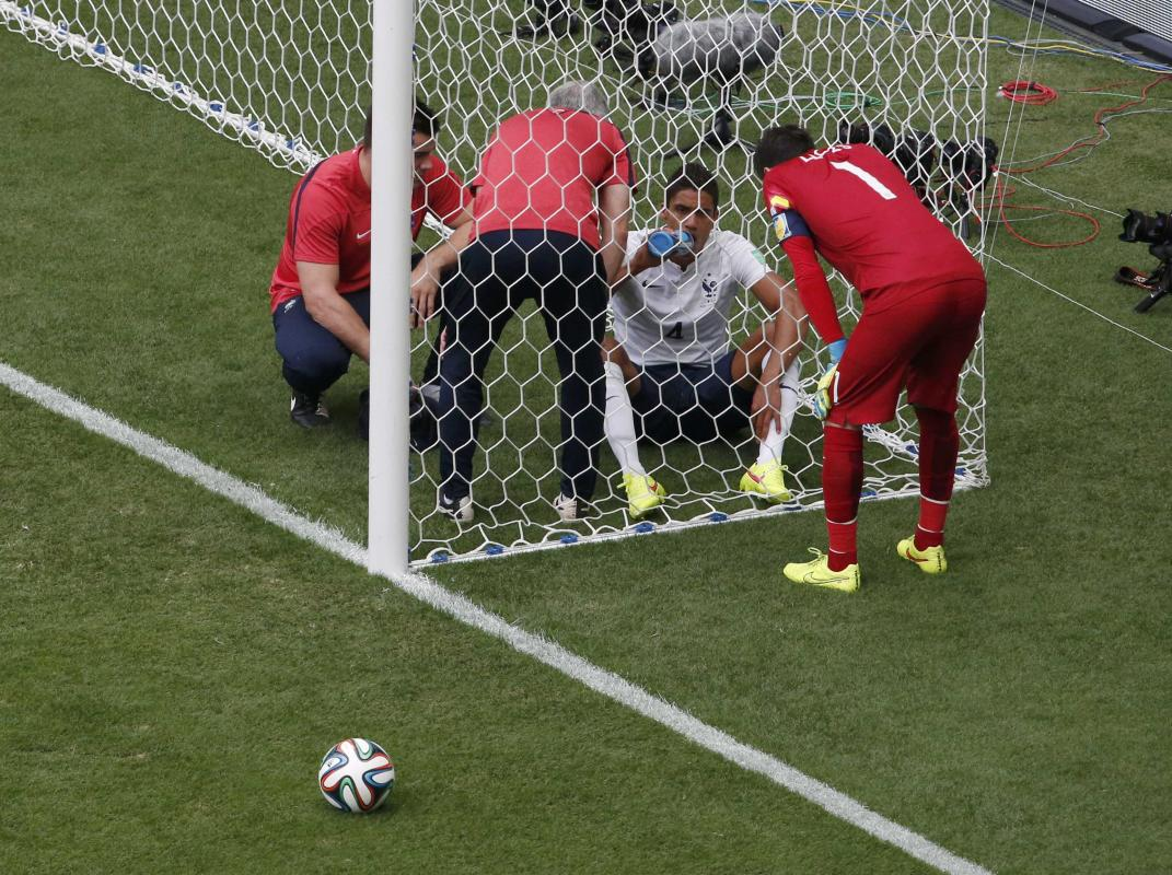 France's goalkeeper Lloris looks at teammate Varane during their 2014 World Cup round of 16 game against Nigeria in Brasilia