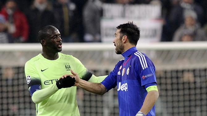 Football Soccer- Juventus v Manchester City - UEFA Champions League Group Stage - Group D - Juventus stadium, Turin, Italy - 25/11/15 Juventus' goalkeeper Buffon and Manchester City's Toure
