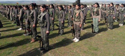 A handout picture released by the Syrian Observatory for Human Rights shows members of the first Kurdish female battalion named Martyr Rokan Battalion in Syrian city of Afrin on February 22, 2013. Around 150 Kurdish women in the war-wracked northern Syrian province of Aleppo have set up a fighting battalion, a monitoring group said on Saturday