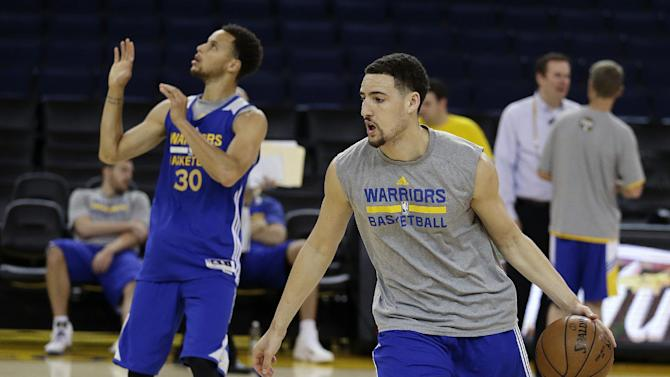 Golden State Warriors' Klay Thompson, right, drives the ball behind Stephen Curry (30) during NBA basketball practice, Wednesday, June 3, 2015, in Oakland, Calif. The Warriors host the Cleveland Cavaliers in Game 1 of the NBA Finals on Thursday. (AP Photo/Ben Margot)