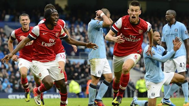 Arsenal's Laurent Koscielny (front R) celebrates scoring against Manchester City during their English Premier League soccer match in Manchester, northern England September 23, 2012 (Reuters)