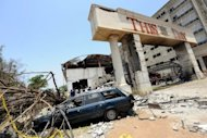 A destroyed car sits outside the premises of ThisDay Newspapers, bombed in the Nigerian capital Abuja in April 2012. An explosion went off on Tuesday at a shopping centre in Abuja, where an unexploded bomb was later discovered, rescue officials said