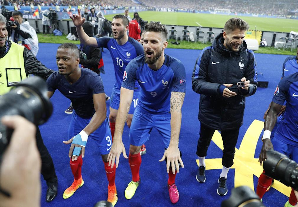 France's Patrice Evra, Olivier Giroud and Andre Pierre Gignac celebrate after the game