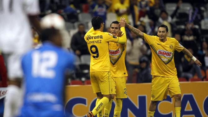 Raul Jimenez of Mexico's Club America celebrates a goal with his teammates during their CONCACAF match against Panama's Sporting San Miguelito in Mexico City
