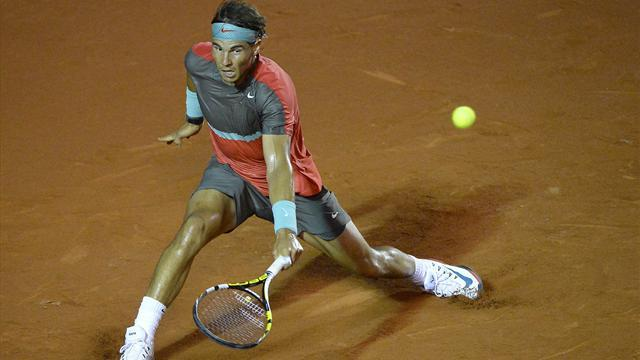 Tennis - Nadal shrugs off sore back to win Rio opener