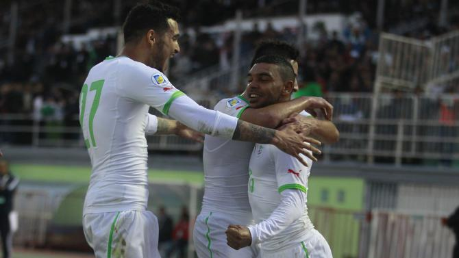 Algeria's Arabi Soudani celebrates with teammates after scoring against Slovenia during their international friendly soccer match in Algiers