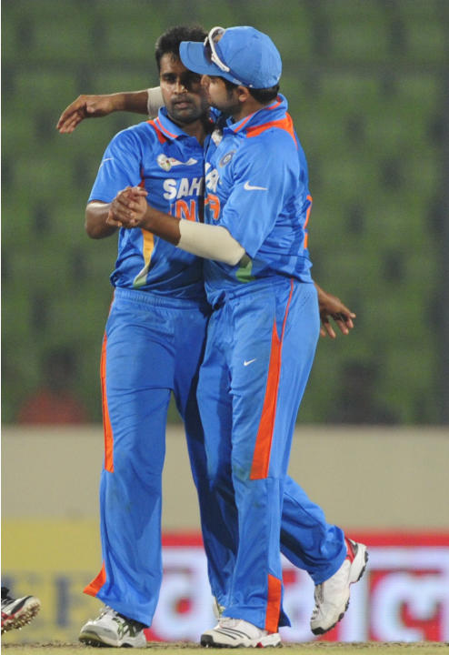 Indian cricketer Suresh Raina (R) congra
