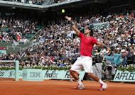 Spain's Rafael Nadal serves to David Ferrer during their French Open semi-final match on June 8. Nadal defeated his fellow Spaniard Ferrer 6-2, 6-2, 6-1 on Friday to reach the French Open final where he will bid to become the first man to win seven titles at Roland Garros