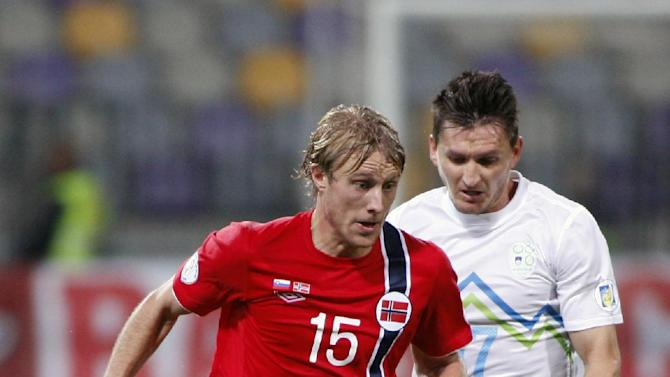 Norway's Per Ciljan Skjelbred left,  is challenged by Slovenia's Nejc Pecnik during the 2014 World Cup group E qualifier soccer match between Slovenia and Norway in Maribor, Slovenia, Friday, Oct 11, 2013