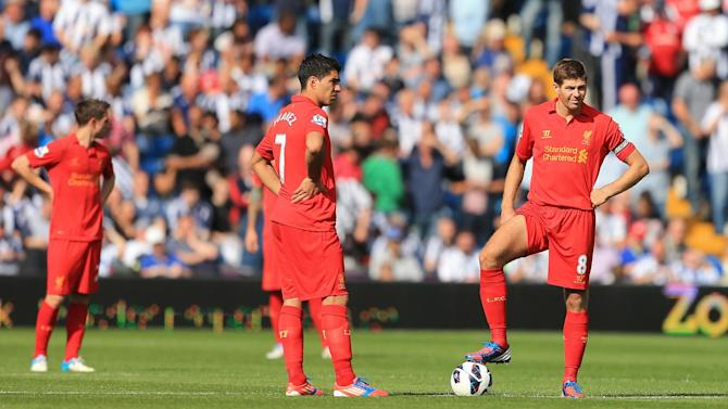 Luis Suarez, left, and Steven Gerrard, right, are among a number of players left behind for the Hearts clash