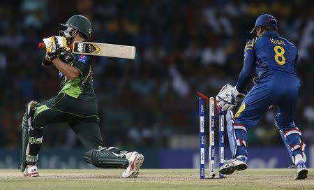 Pakistan's Afridi is bowled out by Sri Lanka's Jayasuriya next to Sri Lanka's wicketkeeper Perera during their second Twenty20 cricket match in Colombo